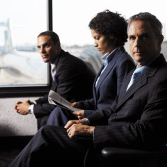 Business Executives Sitting in the Airport --- Image by © Royalty-Free/Corbis